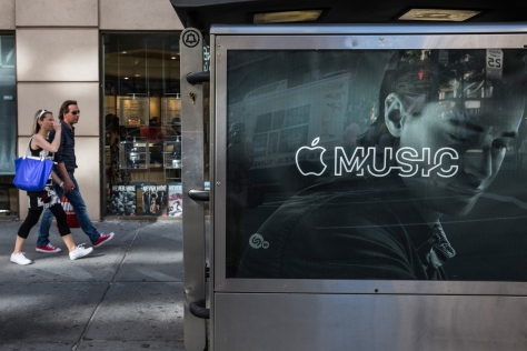 NEW YORK, NY - AUGUST 07:  An advertisement for Apple Music is posted on the streets of Manhattan on August 7, 2015 in New York City. After launching in June Apple announced it has attracted 11 million users during its trial period.  (Photo by Andrew Burton/Getty Images)