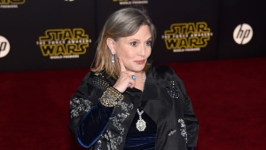 "HOLLYWOOD, CA - DECEMBER 14: Actress Carrie Fisher attends the premiere of Walt Disney Pictures and Lucasfilm's ""Star Wars: The Force Awakens"" at the Dolby Theatre on December 14, 2015 in Hollywood, California. (Photo by Ethan Miller/Getty Images)"