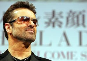 "British singer George Michael poses for photo session prior to a press conference to promote his documentary film ""George Michael, A different story,"" at a hotel in Tokyo, Thursday, Dec 15, 2005. The film, portraying his life in both bright and dark sides, will be released Dec 23. (AP Photo/Junji Kurokawa)"